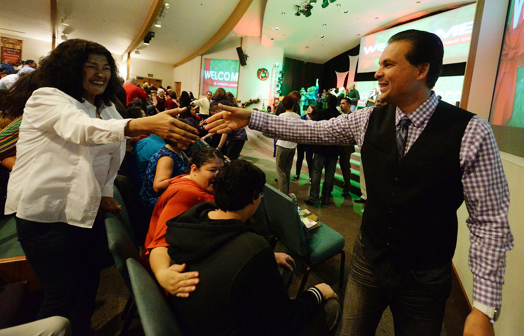 Description of . Way World Outreach Church Pastor Marco Garcia leads his congregation Sunday December 15, 2013 in San Bernardino. He is the co-founder of the rapidly growing church which has been generous in providing for the homeless and others in need. (Will Lester/Inland Valley Daily Bulletin)