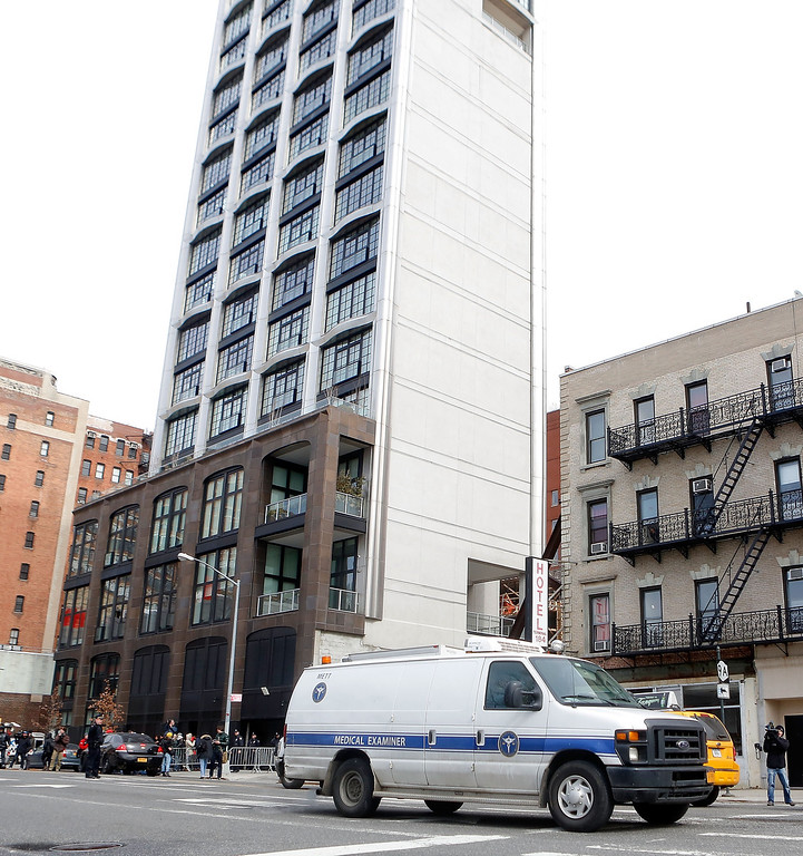 Description of . The medical examiners van departs the  Chelsea apartment building transporting the body of Fashion Designer L'Wren Scott, who was found dead earlier from an apparent suicide on March 17, 2014 in New York City.  (Photo by Jemal Countess/Getty Images)