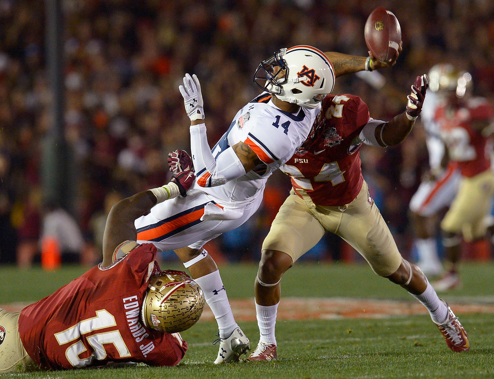Description of . Auburn quarterback Nick Marshall throws the ball away during the first half of the 2014 Vizio BCS National Championship January 6, 2014 in Pasadena CA.(Andy Holzman/Los Angeles Daily News)