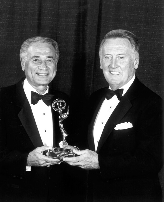 Description of . Academy of Television Arts & Sciences president Leo Chaloukian presents the annual Governors Award to Vin Scully in 1992.   L.A. Daily News file photo