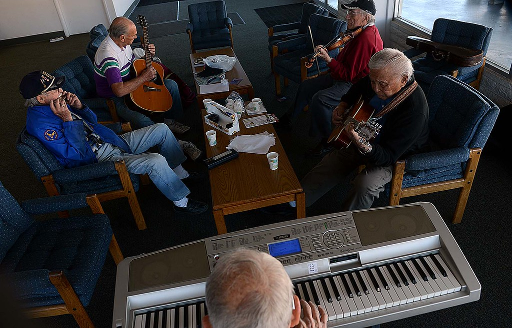 Description of . The Redlands Airport Philharmonic gather each Wednesday in the lobby of the Redlands Airport to share stories, coffee, donuts and