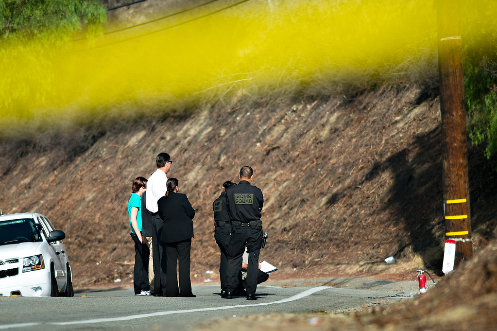 Description of . Los Angeles County sheriff's officials investigate the scene where an unidentified burned body was found along the side of Covina Hills Road west of Via Verde Street in the unincorporated area of Covina on Tuesday morning, August 20, 2013. (SGVN/Staff photo by Watchara Phomicinda)