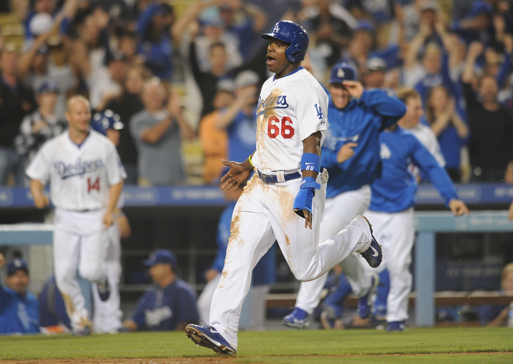 Description of . Yasiel Puig heads home after being driven in on a Adrian Gonzalez double to win the game. The Dodgers defeated the New York Mets 5-4 in 12 innings at Dodger Stadium in Los Angeles, CA. 8/14/2013  (John McCoy/LA Daily News)