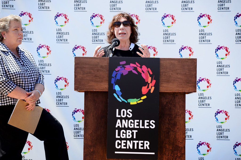Description of . Comedian Lily Tomlin speaks to the press after Lorri Jean, left, CEO of the Los Angeles LGBT Center,  announced a $25 million campaign to develop an affordable housing campus for LGBT youth and seniors Tuesday, May 27, 2014 on Santa Monica Boulevard in Hollywood and adjacent to their cultural center. Around 40 percent of the more than 6,000 homeless youth in Los Angeles identify as lesbian, gay, bisexual or transgender and the city has 65,000 LGBT seniors according to the L.A. Gay & Lesbian Center. The center has raised $19 million. (Photo by Sarah Reingewirtz/Pasadena Star-News)