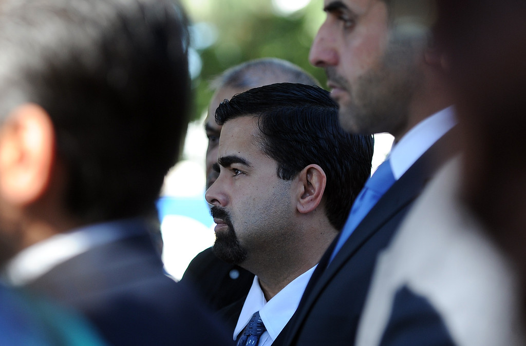 Description of . City of Bell Gardens mayor Daniel Crespo looks on during a press conference with concerned regional elected officials calling for Senator Ron Calderon to resign his position in the California State Senate in front of the Bell Gardens City Hall in Bell Gardens , Calif., on Wednesday, Nov. 13, 2013.   (Keith Birmingham Pasadena Star-News)
