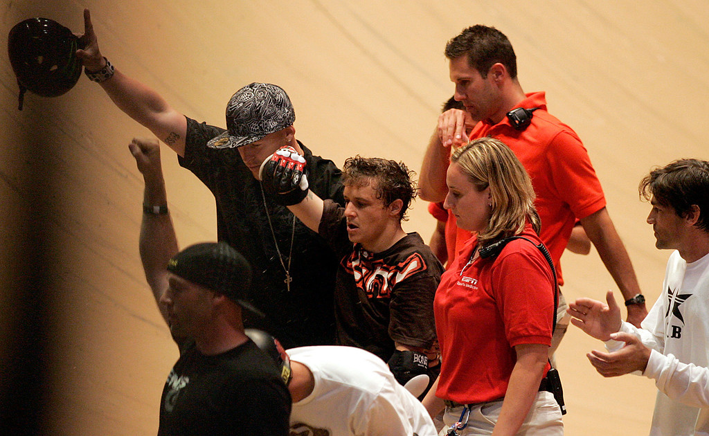 Description of . Jake Brown, center, walks away after taking a 50-foot plunge into the skateboarding abyss after completing the very elusive 720 degree spin during X Games 13 at Staples Center in Los Angeles California on August 2, 2007.  He remained on the ground for about ten minutes while medical personnel tended to him. (SGVN/Staff Photo by Raul Roa/Sports)
