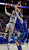 Georgetown's Nate Lubick, left, shoots against Florida Gulf Coast's Brett Comer, right, and Sherwood Brown during the first half of a second-round game of the NCAA college basketball tournament on Friday, March 22, 2013, in Philadelphia. (AP Photo/Matt Rourke)