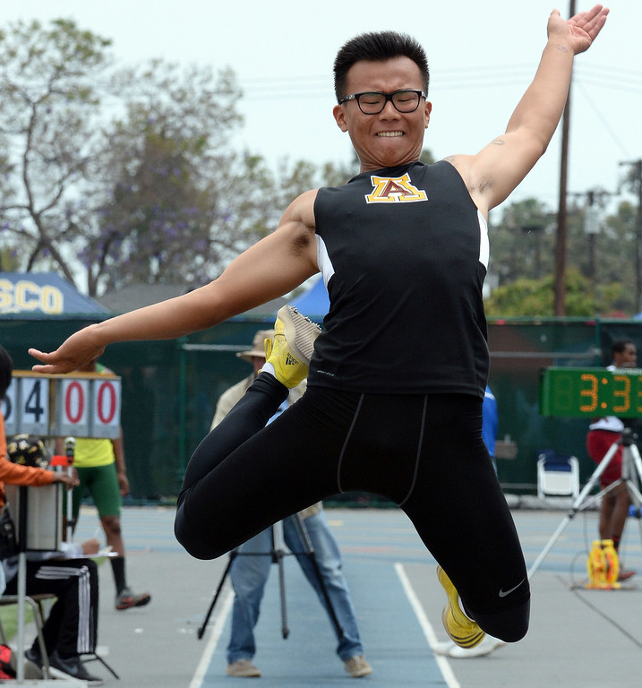 Description of . Arcadia's Sung Shin Cho competes in the division 1 long jump during the CIF Southern Section track and final Championships at Cerritos College in Norwalk, Calif., Saturday, May 24, 2014. 