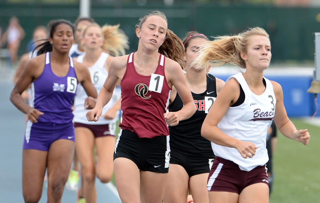 Description of . Oaks Christian's Julia Sullivan competes in the division 4 800 meters race during the CIF Southern Section track and final Championships at Cerritos College in Norwalk, Calif., Saturday, May 24, 2014. 