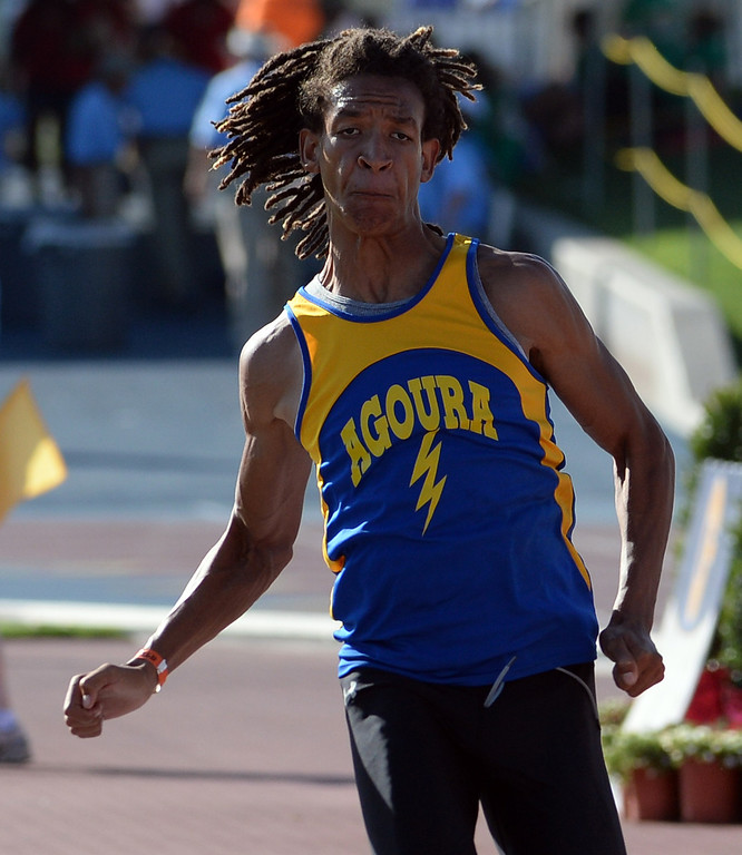 Description of . Agoura's Idrees Bernard competes in the triple jump  during the CIF California State Track & Field Championships at Veteran's Memorial Stadium on the campus of Buchanan High School in Clovis, Calif., on Saturday, June 7, 2014.   (Keith Birmingham/Pasadena Star-News)