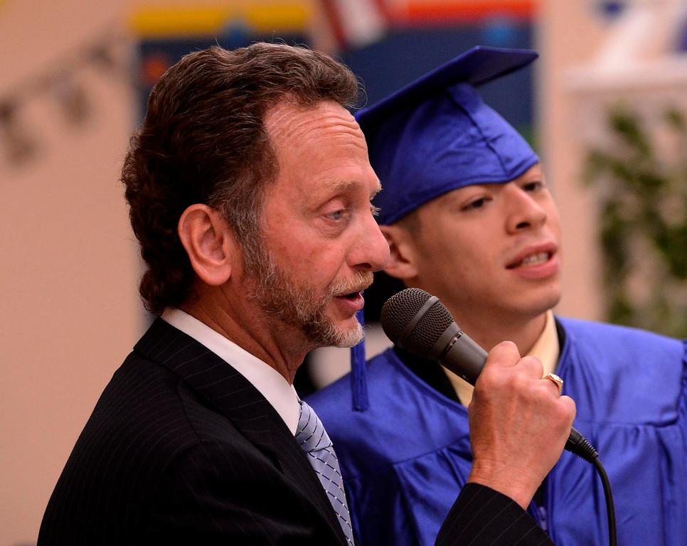 Description of . Nick Cataldo speaks alongside graduate Alfredo Yanez during Commencement Ceremonies at Carl And Dora Anderson School in San Bernardino May 21, 2013.  GABRIEL LUIS ACOSTA/STAFF PHOTOGRAPHER.