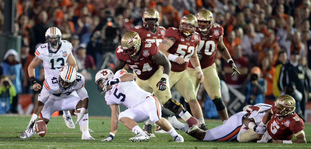Description of . Florida State quarterback Jameis Winston (5) fumbles as Auburn recovers in the first half of the BCS National Championship game at the Rose Bowl in Pasadena, Calif., on Monday, Jan. 6, 2014.   (Keith Birmingham Pasadena Star-News)