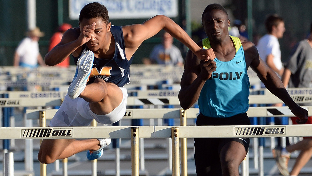 Description of . Millikan's Misana Viltz, left, along with Long Beach Poly's Juan Ward competes in the 110 meter hurdles during the CIF-SS Masters Track and Field meet at Falcon Field on the campus of Cerritos College in Norwalk, Calif., on Friday, May 30, 2014.   (Keith Birmingham/Pasadena Star-News)