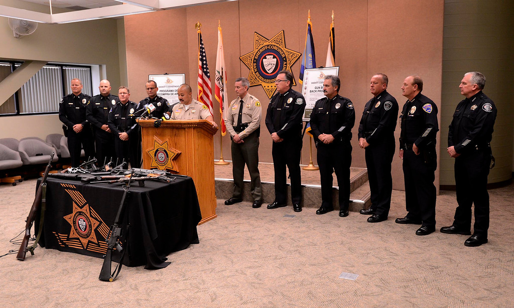 Description of . Local law enforcement officers appear at a SBCO Sheriff's  press conference for the announcement of the first Countywide Gun Buy Back Program May 31, 2013.  GABRIEL LUIS ACOSTA/STAFF PHOTOGRAPHER.