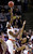 Syracuse forward C.J. Fair, left, shoots over Montana forward Spencer Coleman during the first half of a second-round game in the NCAA college basketball tournament in San Jose, Calif., Thursday, March 21, 2013. (AP Photo/Jeff Chiu)