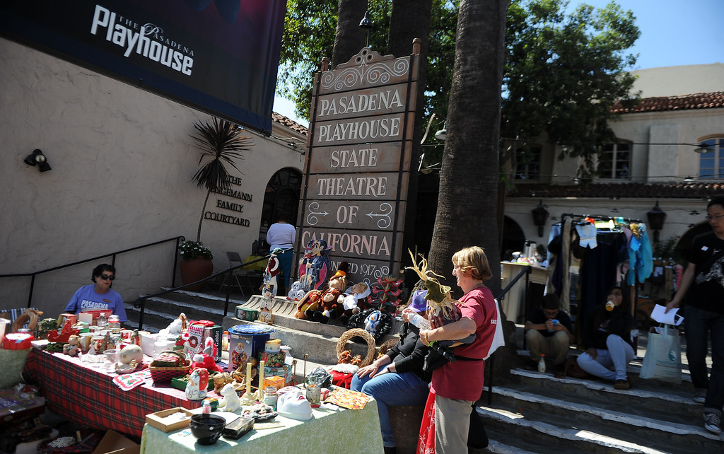 Description of . Yard sales at the Pasadena playhouse during the 8th Annual Pasadena ARTWalk along El Molino Avenue between Colorado Boulevard and Green Street in Pasadena, Calif., on Saturday, Oct. 12, 2013. The ArtWalk features over 30 participating artists, art sales, gallery walks, musical performances and other activities.   (Keith Birmingham Pasadena Star-News)