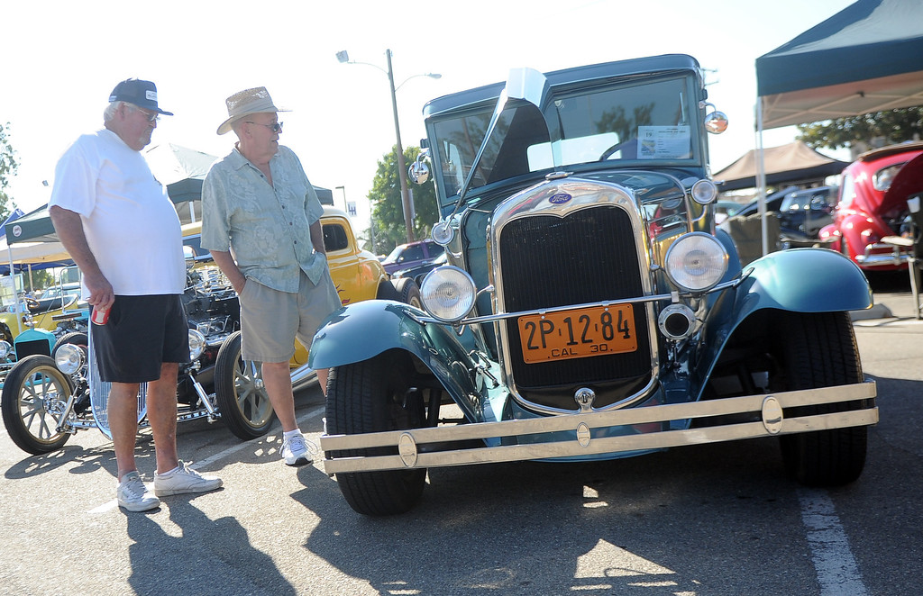 Description of . Ray Martin, left, along with Grant Hollingsworth look over a 1920's Ford during the 4th annual La Habra Highlanders car show at La Habra High School in La Habra Calif. on Saturday, Sept. 7, 2013.   (Photo by Keith Birmingham/Pasadena Star-News)