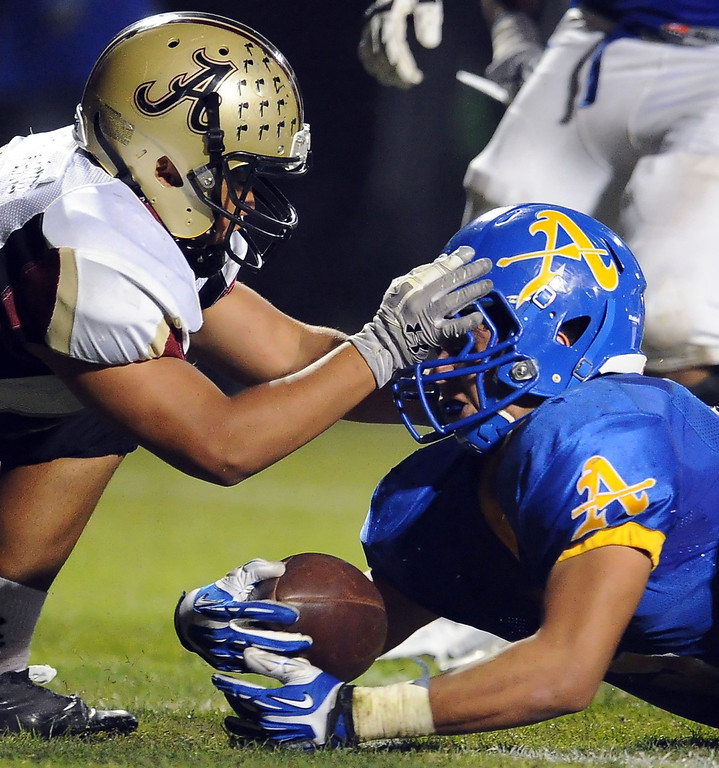 Description of . Alemany defense stops Bishop Amat's Anthony Camargo (C) at the goal line in the first half of a prep football game at Bishop Amat High School in La Puente, Calif., on Friday, Oct. 25, 2013.    (Keith Birmingham Pasadena Star-News)