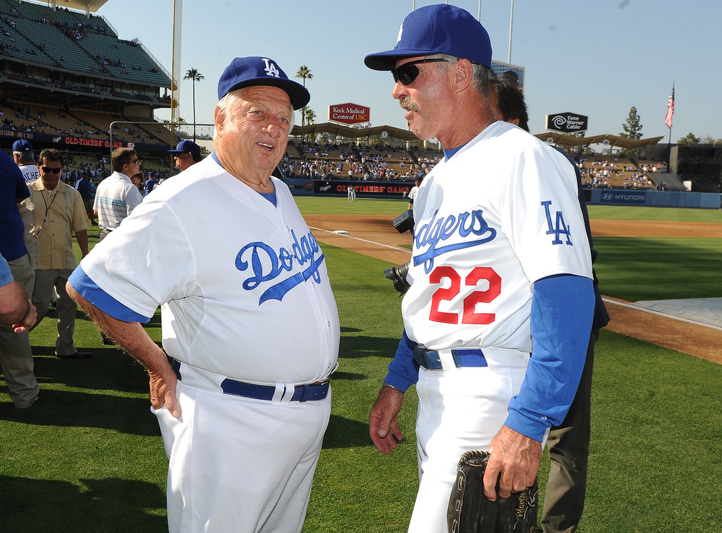 Description of . Former Los Angeles Dodgers manager Tommy Lasorda, left, with Bill Buckner (22) during the Old-Timers game prior to a baseball game between the Atlanta Braves and the Los Angeles Dodgers on Saturday, June 8, 2013 in Los Angeles. 