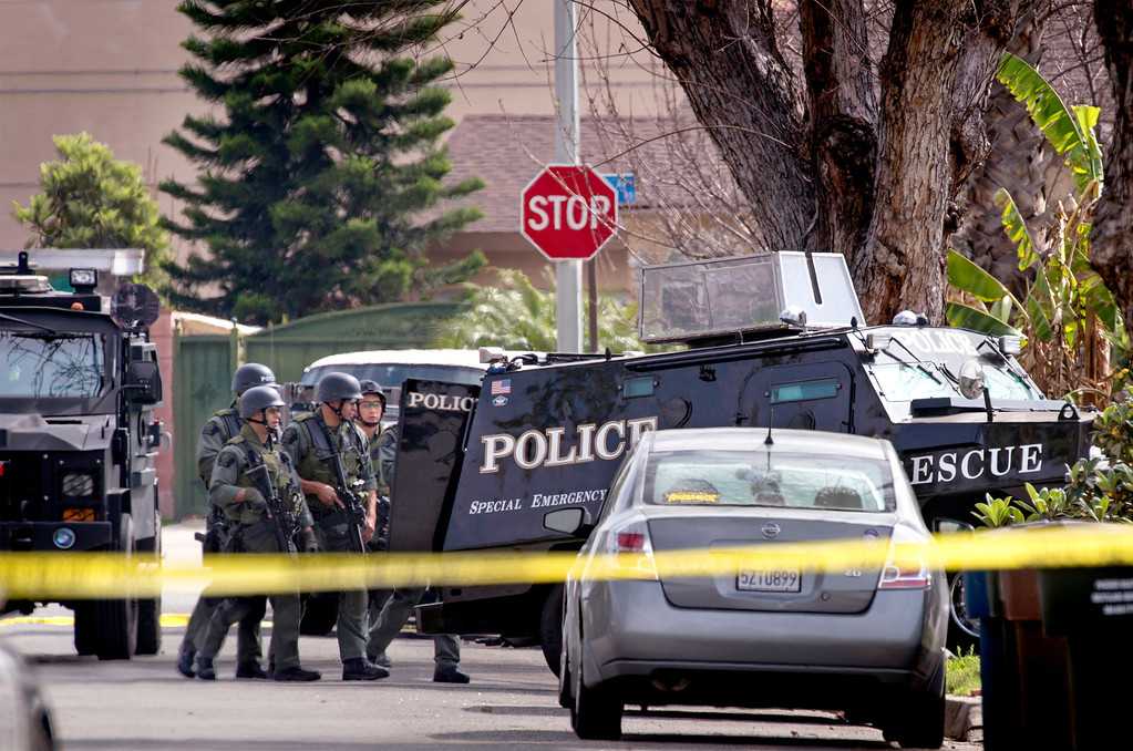 Description of . SWAT Team on the scene of a barricaded suspect after a person was shot in the 14400 block of Elmcrest Street in El Monte, Calif. March 7, 2014.   (Staff photo by Leo Jarzomb/San Gabriel Valley Tribune)