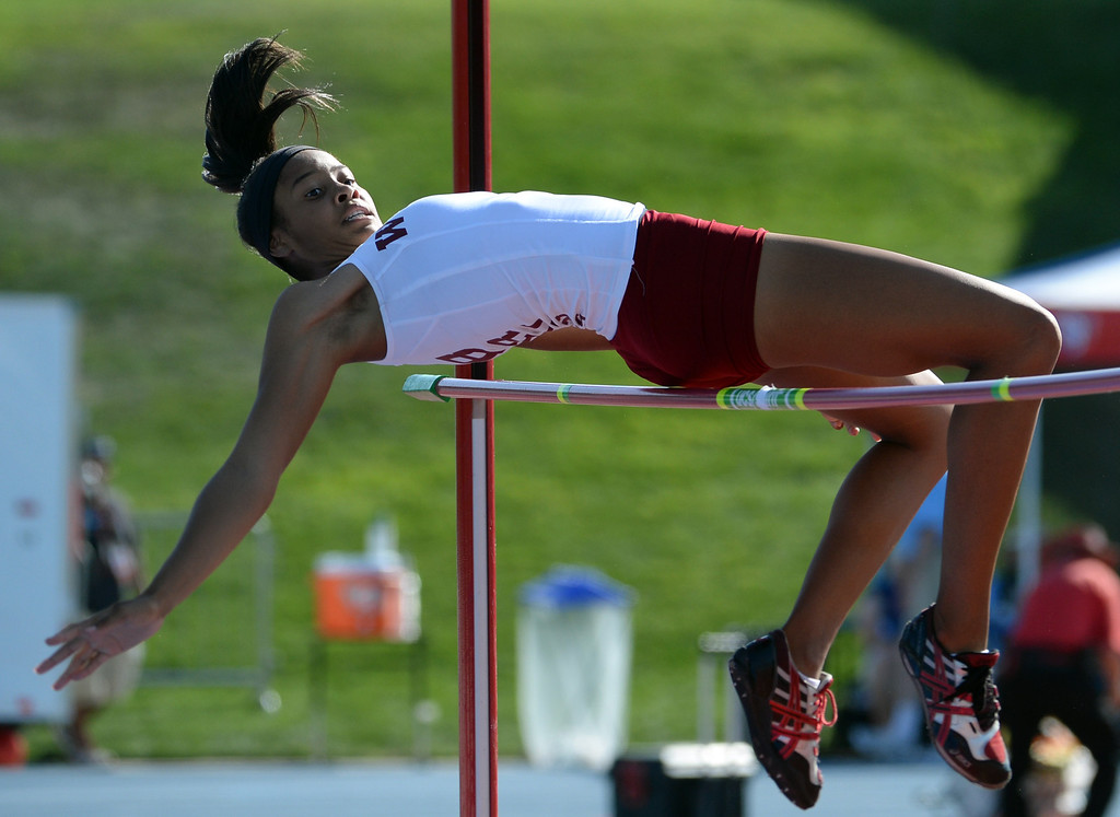 Description of . Long Beach Wilson's Kaelin Davis competes in the High Jump  during the CIF California State Track & Field Championships at Veteran's Memorial Stadium on the campus of Buchanan High School in Clovis, Calif., on Saturday, June 7, 2014. 
