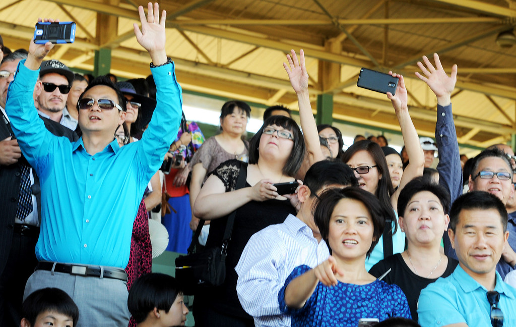 Description of . Parents watching and photographing graduates.  Gabrielino High in San Gabriel School Class of 2014 graduation was held at Santa Anita Park in Arcadia Wednesday, June 4, 2014.Photo by Walt Mancini/Pasadena Star-News)