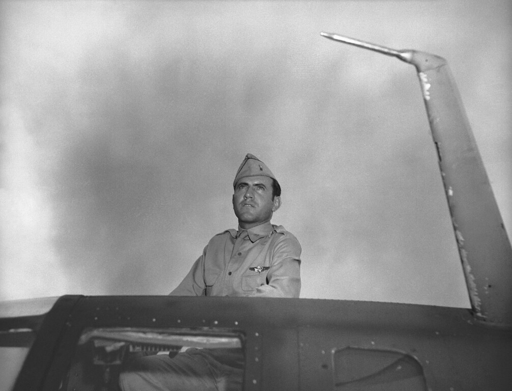 Description of . Louis Zamperini, former USC athletic star now a bombardier in the Army Airforce, peers out of hatch nose of bomber on Jan. 1, 1943. Zamperini was bombardier of one of the planes in recent raid on Japanese-held Wake Island. (AP Photo/Jack Rice)