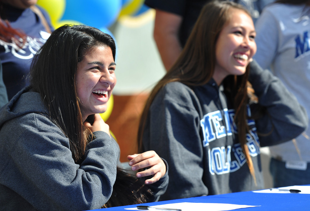 Description of . Girls Soccer players Ileen Mejia, left, and Samantha Scovel, appear during National Signing Day at La Mirada High School on Wednesday February 5, 2014. (Staff Photo by Keith Durflinger/Whittier Daily News)