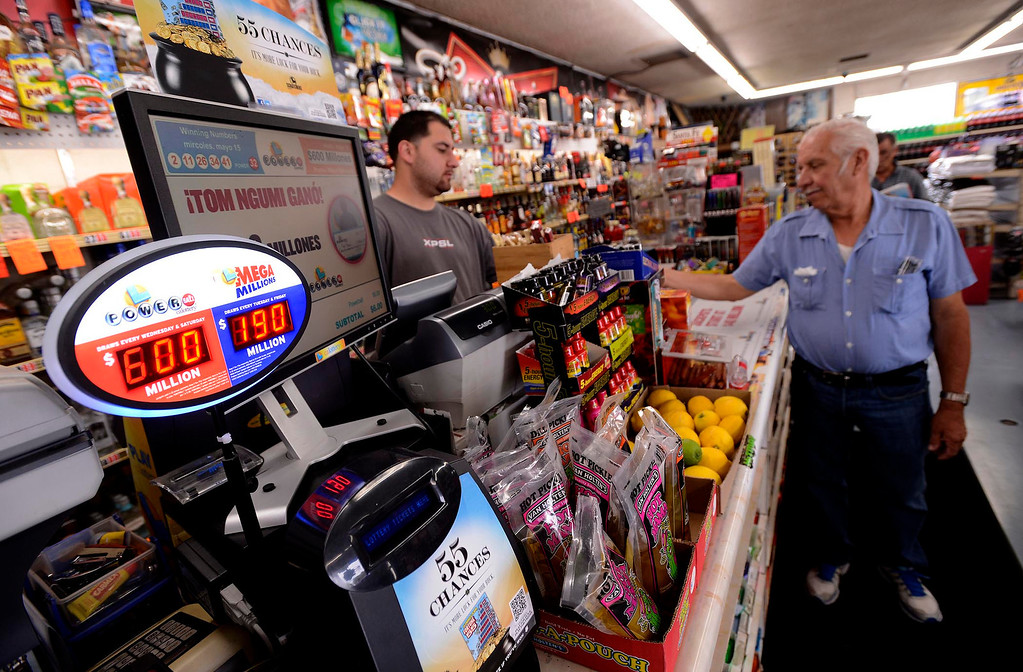 Description of . Vincent de Dios, of Fontana, buys a Powerball ticket at Quicker Liquor along Sierra Avenue in Fontana May 17, 2013.  The Powerball Lottery, which California just joined earlier this year, is at $600 million for Saturday's drawing.  It is the third-highest jackpot in U.S. history.  GABRIEL LUIS ACOSTA/STAFF PHOTOGRAPHER.