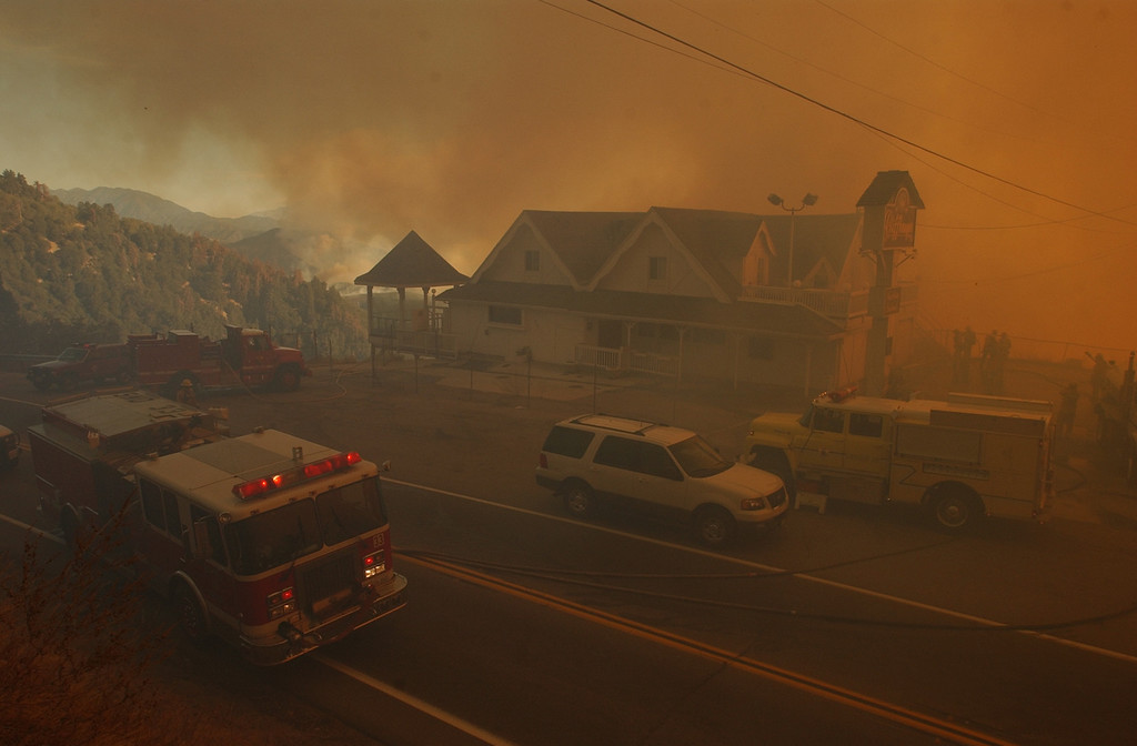Description of . Ten years ago this month the arson caused Old Fire, fanned by Santa Ana winds burned thousands of acres, destroyed hundreds of homes and caused six deaths. The fire burned homes in San Bernardino, Highland, Cedar Glen, Crestline, Running Springs and Lake Arrowhead and forced the evacuation of thousand of residents. The Cliffhanger Restaurant surrounded with smoke sits along Highway 18 during the