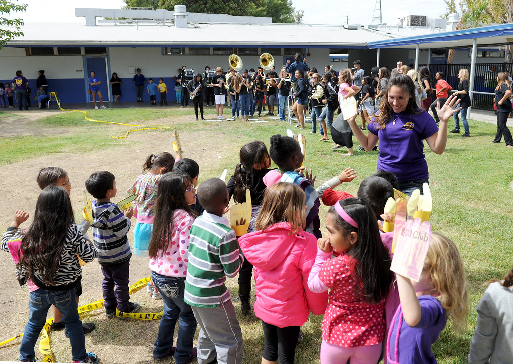 Description of . (John Valenzuela/Staff Photographer) Kindergarten teacher Brittany Bryan of Lugonia Elementary in Redlands, dances with her class during an afternoon pep rally, celebrating the school's 808 API score, Thursday, September 26, 2013.