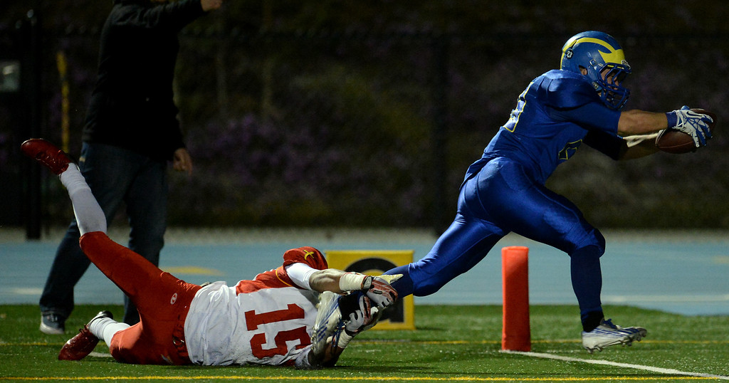 Description of . San Dimas' Joseph Mayorga (23) runs for the winning touchdown as Paraclete's Triston Brown (15) tries to tackle in the fourth quarter of a CIF-SS Mid-Valley Division championship football game at San Dimas High School in San Dimas, Calif., on Friday, Dec. 6, 2013. San Dimas won 20-14.  (Keith Birmingham Pasadena Star-News)