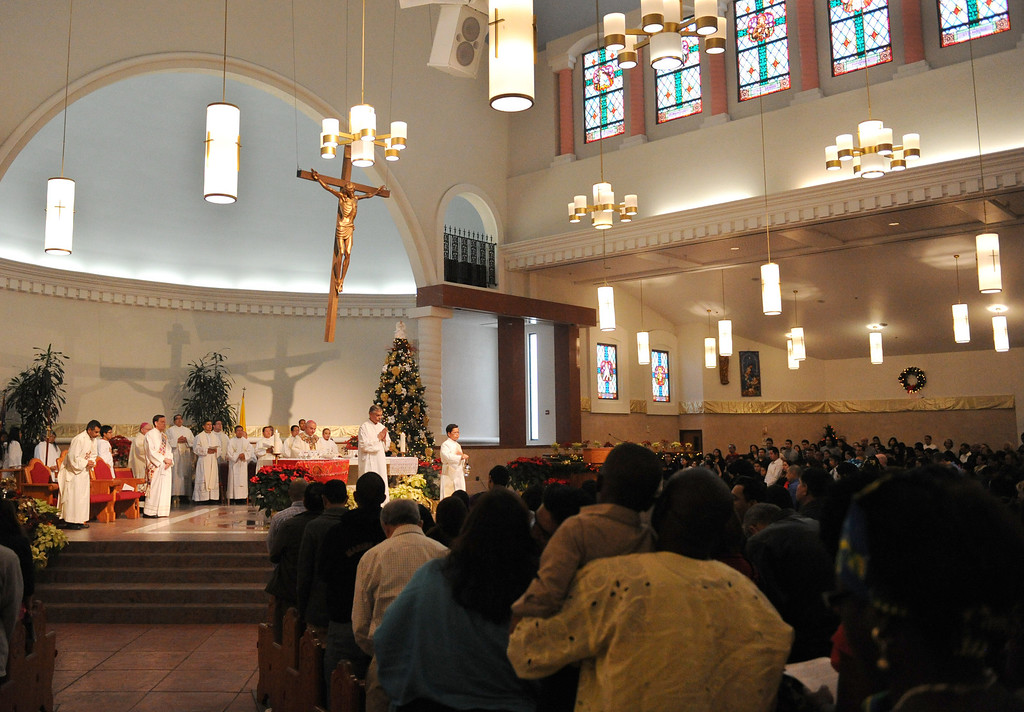 Description of . Bishop of the Diocese of San Bernardino Gerald Barnes, leads the 8th annual Diocesan Migration Mass at Sacred Heart Church in Rancho Cucamonga, Sunday, Jan. 12, 2014.