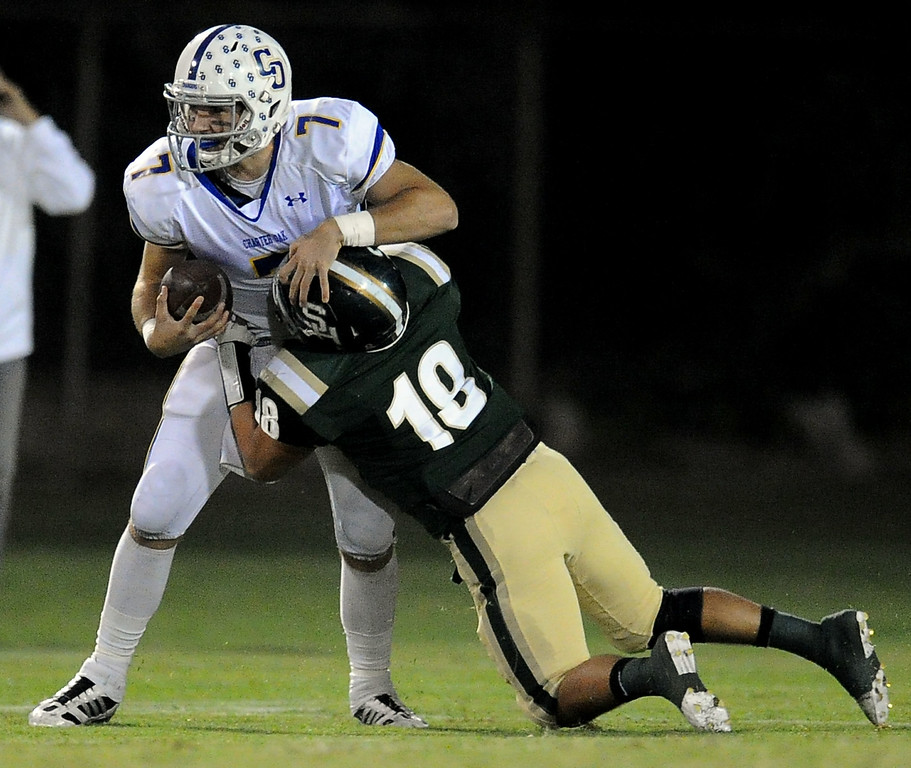 Description of . Charter Oak quarterback Kory Brown (7) scrambles as South Hills' Matthew Chavez (18) tackles in the first half of a prep football game at Covina DIstrict Field in Covina, Calif., on Thursday, Oct. 24, 2013. 