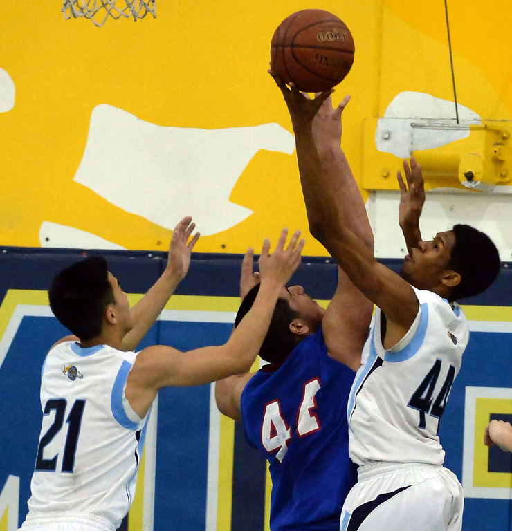 Description of . Walnut's Richard Rycraw (C) (44) drives top the basket over Los Altos' Jayson Jones (44) as Jeff Huang (21) looks on in the first half of a prep basketball game at Walnut High School in Walnut, Calif., on Wednesday, Jan. 22, 2014. (Keith Birmingham Pasadena Star-News)
