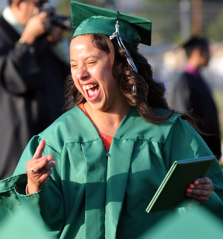 Description of . Graduates get their diplomas during the 53rd Annual Commencement at Pioneer High School in Whittier on Wednesday June 12, 2013. (SGVN/Staff Photo by Keith Durflinger)