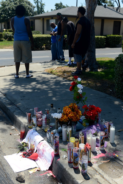 Description of . A memorial for Angel Bravo Monday, August 12, 2013, in the 1700 block of Benedict Way in Pomona. Bravo, 29, was shot and killed while standing near his vehicle early Sunday morning.  Jennifer Cappuccio Maher/Staff Photographer