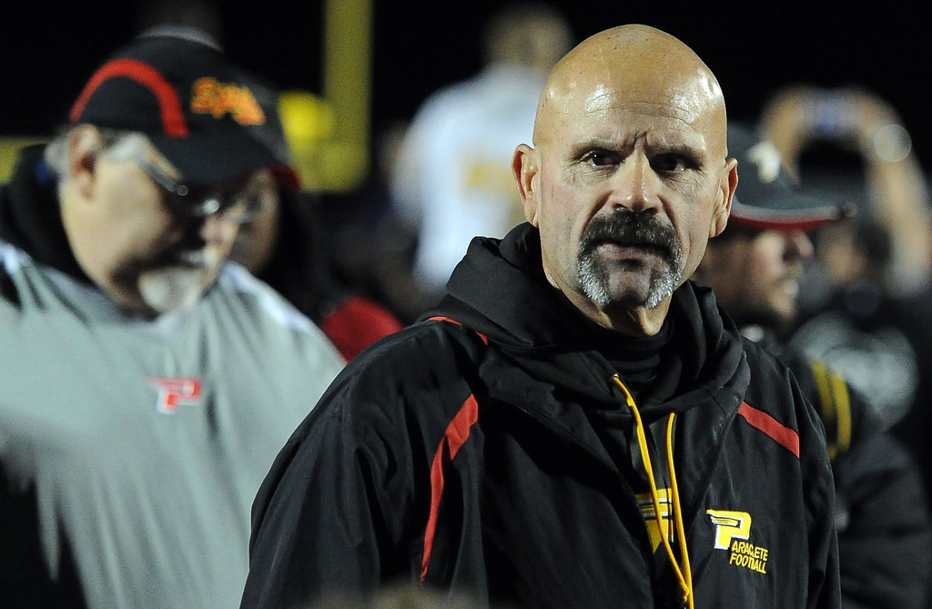Description of . Paraclete head coach Norm Dahlia talks to his team after losing to San Dimas 20-14 a CIF-SS Mid-Valley Division championship football game at San Dimas High School in San Dimas, Calif., on Friday, Dec. 6, 2013.   (Keith Birmingham Pasadena Star-News)