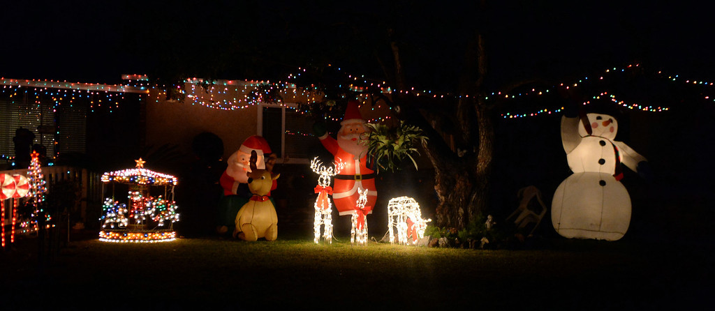 Description of . A home is decorated with holiday lights along Devanah St. and Lark Ellen in Covina, Calif., on Thursday, Dec. 19, 2013.     (Keith Birmingham Pasadena Star-News)
