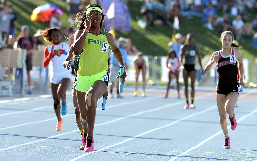 Description of . Long Beach Poly's Ariana Washington runs the final leg as Poly wins the 4x100 meter relay during the CIF California State Track & Field Championships at Veteran's Memorial Stadium on the campus of Buchanan High School in Clovis, Calif., on Saturday, June 7, 2014.   (Keith Birmingham/Pasadena Star-News)