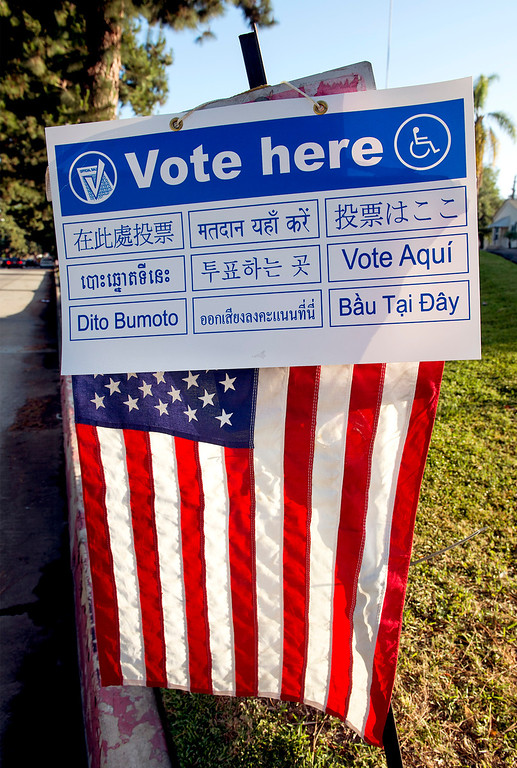 Description of . An American flag marks the polling entrance at the Greenleaf Masonic Temple on Beverly Boulevard in Whittier, Calif. Tuesday morning June 3, 2014.   (Staff photo by Leo Jarzomb/Whittier Daily News)