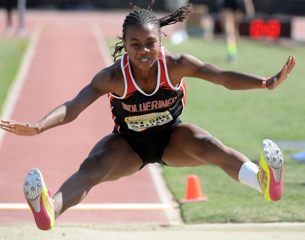 Description of . Harvard Westlake's Courtney Corn competes in the long jump Invitational during the Mt. SAC Relays in Hilmer Lodge Stadium on the campus of Mt. San Antonio College in Walnut, Calif., on Saturday, April 19, 2014. 