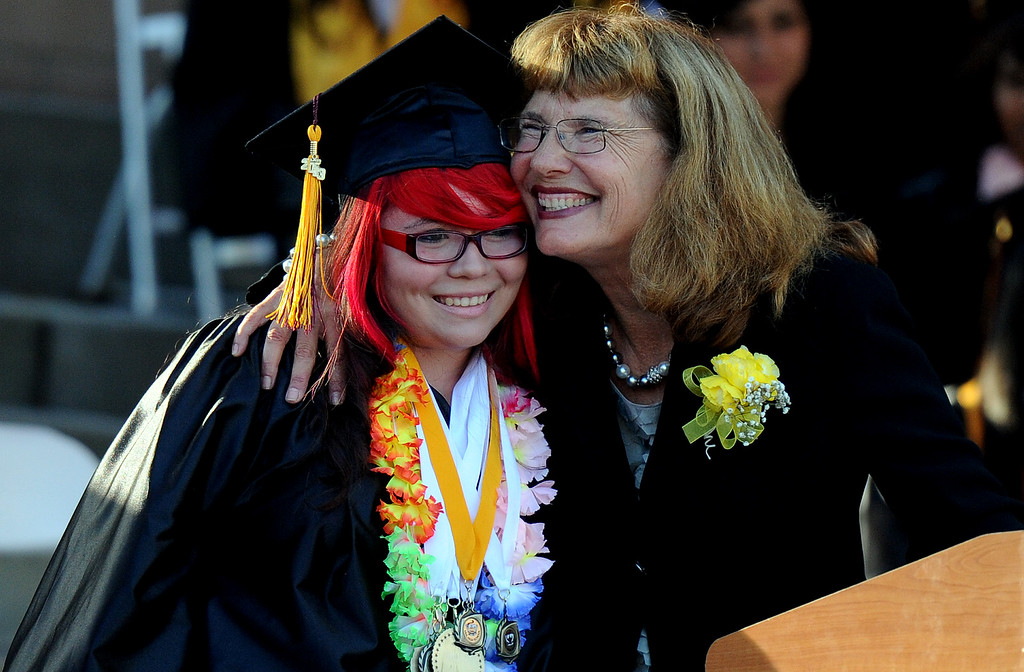 Description of . Principal Suzette Montano, right, hugs graduate Desiry M. Alaniz during the Vail High School commencement at Vail High School on Tuesday, June 18, 2013 in Montebello, Calif.