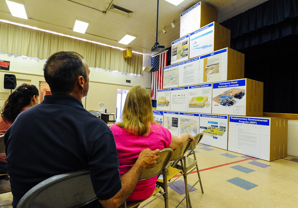 Description of . Husband and wife Rick and Sherry Powell, who are 10-year Hinkley residents, study a pyramid visually representing PG&E's Hinkley remediation strategy process over time during a Community Advisory Committee meeting in the Hinkley School auditorium in Hinkley, Calif. on Thursday, June 27, 2013.