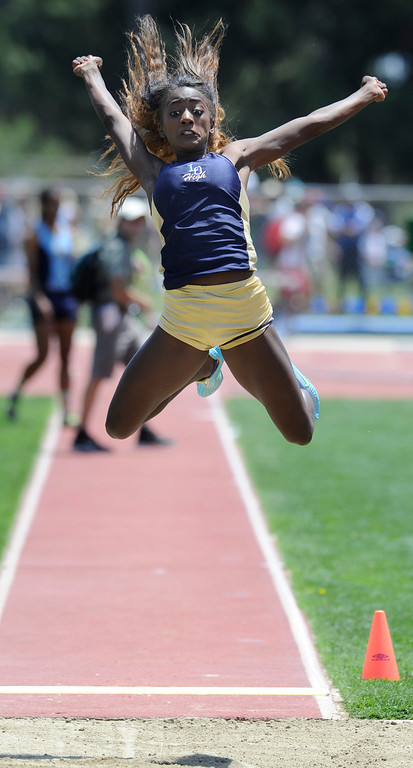 Description of . Kira Moreland from Los Osos competes in the long jump during the 2013 CIF Southern Section Track & Field Divisional Finals held at Mt. San Antonio College in Walnut, CA 5/18/2013(John McCoy/LA Daily News)