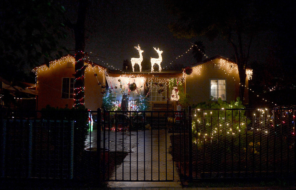 Description of . A house is lit up for the holidays on the 900 block of North Summit Avenue in Pasadena Thursday night, December 19, 2013. (Photo by Sarah Reingewirtz/Pasadena Star-News)