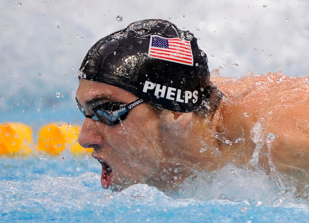 Description of . United States Michael Phelps swims to the gold in the men's  4x100-meter medley relay final during the swimming competitions in the National Aquatics Center at the Beijing 2008 Olympics in Beijing, Sunday, Aug. 17, 2008. (AP Photo/Mark J. Terrill)