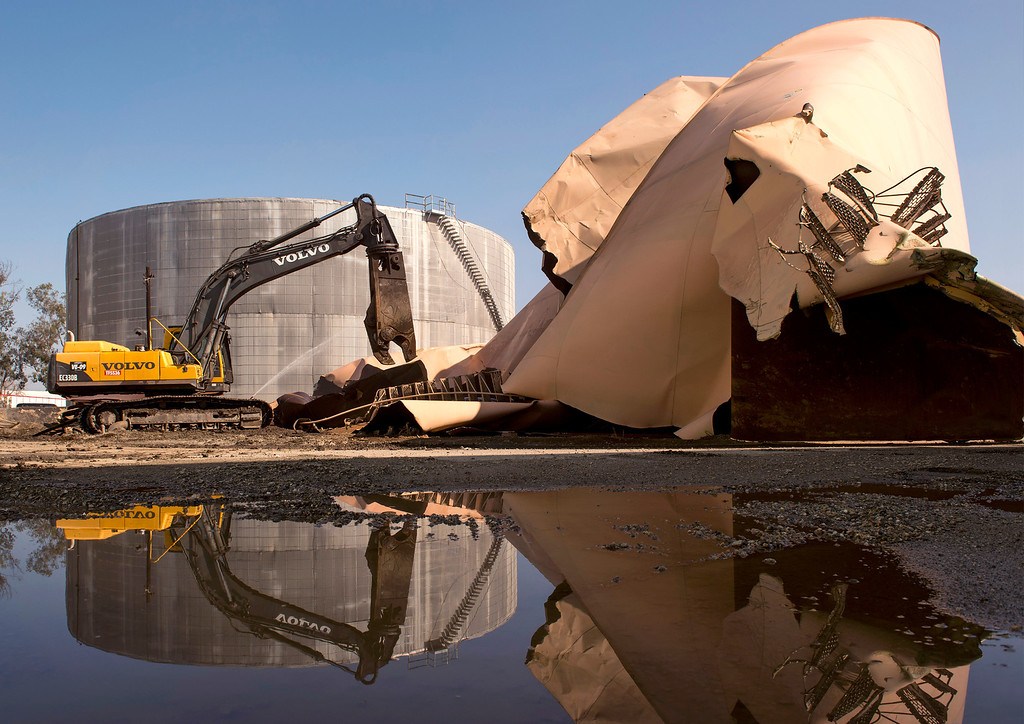 Description of . Demolition of four waste-water storage tanks at Ridgeline Energy Services has begun at the Santa Fe Springs, Calif. location Feb. 25, 2014.  The tanks at the former Powerine Oil Company site have been the source of foul odors affecting local neighborhoods.   (Staff photo by Leo Jarzomb/Whittier Daily News)