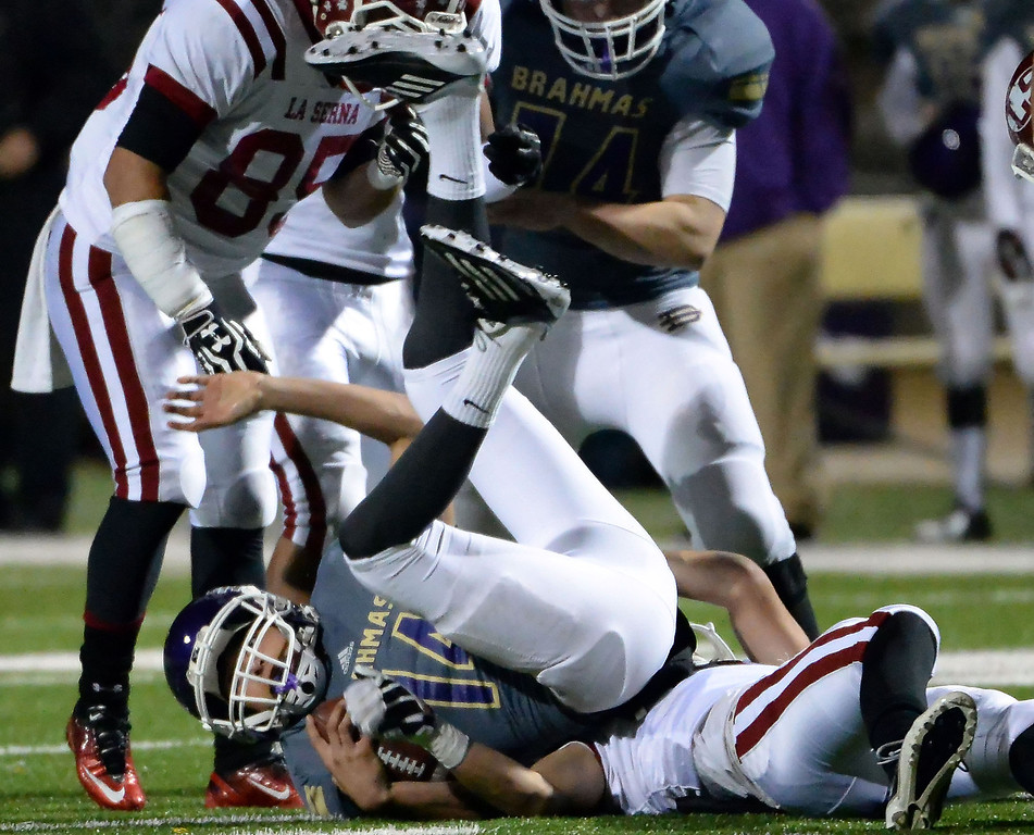 Description of . Diamond Bar's Tyler Peterson (C) (14) is tackled by the La Serna defense in the first half of a CIF-SS playoff football game at Diamond Bar High School in Diamond Bar, Calif., on Friday, Nov. 22, 2013.   (Keith Birmingham Pasadena Star-News)
