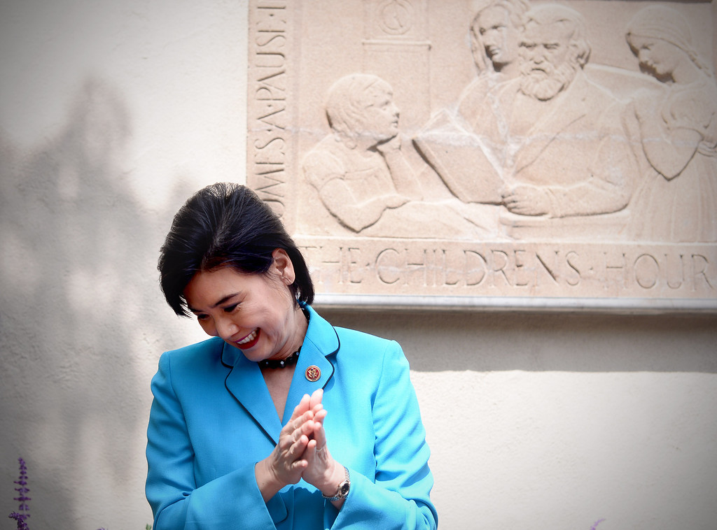 "Description of . Merrell Gage's recently restored 1930 bas relief masterpiece, ""The Children's Hour"" is unveiled by Congresswoman Judy Chu and South Pasadena Mayor Marina Khubesrian at South Pasadena Public Library Friday, March 21, 2014. The 600 lb. stone casting survived fire, breakage, and being buried until it was deemed to possess great local and national significance. (Photo by Sarah Reingewirtz/Pasadena Star-News)"